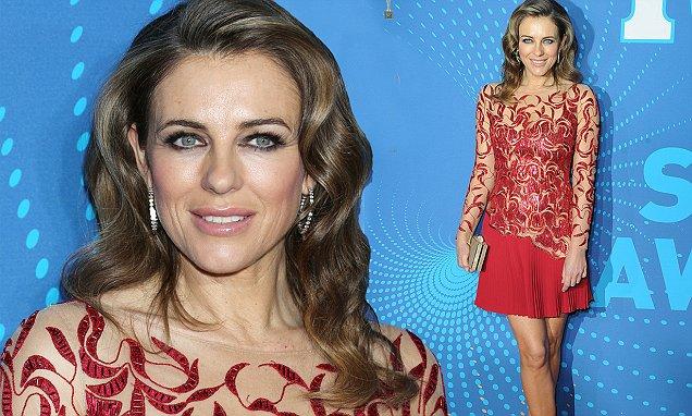 Elizabeth Hurley en rouge chic tenue.jpg